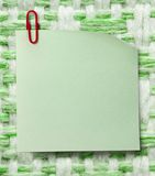 Blank green sticker and red clip Royalty Free Stock Photos