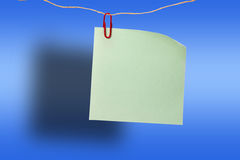 Blank green sticker and red clip Royalty Free Stock Photography
