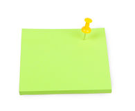 Blank green sticky note with yellow push pin Stock Photo