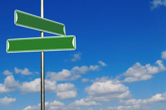 Blank Green Street Name Signs Agains a Bright Blue Stock Photography