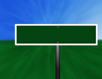 Blank Green Street Sign. A graphic blank green and white street sign against a sky and grass background Stock Photography