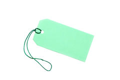 Blank green tag tied with string on white. Royalty Free Stock Photography