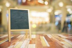 Blank green wooden blackboard for restaurant menu. Mock up Royalty Free Stock Photography