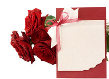 Blank greeting and a bouquet of red roses. Isolated Royalty Free Stock Photography