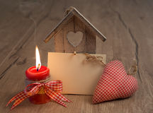 Blank greeting card with candle, decorative birdhouse and heart Stock Photography
