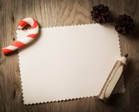 Blank greeting card for Christmas and pencil on wooden backgroun Stock Photography