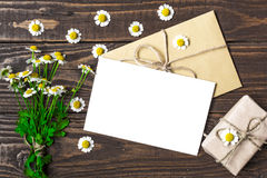 Blank greeting card and envelope with white chamomile flowers and vintage gift box Royalty Free Stock Photography