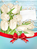 Blank greeting card. EPS 10. Tulip bouquet and blank greeting card. Top view over white blue wooden table. EPS 10 vector file included Stock Photos