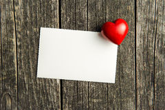 Blank greeting card and heart. Royalty Free Stock Photo