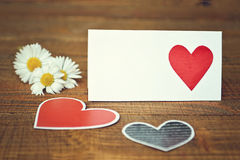 Blank greeting card, hearts and daisies Stock Images
