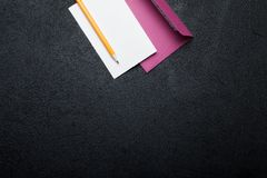 Blank greeting card or letter, pencil and pink envelope for creative design. Empty space for text royalty free stock photo