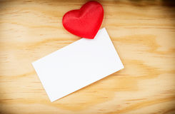 Blank greeting card and a red heart Royalty Free Stock Image