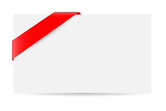 Blank greeting card and red ribbon, isolated on white Stock Images