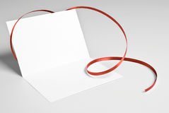 Blank greeting card with red ribbon Royalty Free Stock Photos