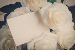 Blank greeting card with white artificial rose Stock Photos