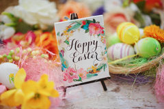 Blank greeting among the Easter eggs Joyful colorful spring background stock photography
