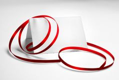 Blank greeting or thank you card decorated with red ribbon. Over grey background Stock Images