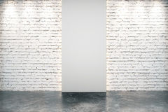 Blank grey part of white brick wall in empty room with concrete Stock Photography