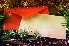 Blank grunge christmas card with colored tinsel Royalty Free Stock Image