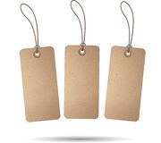 Blank Grunge Tag. Three brown tags hanging on ropes, white background Royalty Free Stock Image