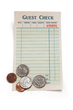 Blank Guest Check and Coin. Concept of restaurant tip Royalty Free Stock Photography