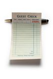 Blank Guest Check and pen. Concept of restaurant expense Royalty Free Stock Images
