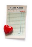 Blank Guest Check and red heart. Concept of Valentine's Day restaurant expense Stock Images