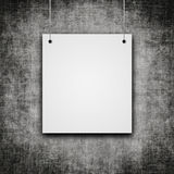 Blank hanging on grunge wall. White blank hanging on grunge wall with place for text Stock Image