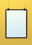 Blank hanging poster template 3d illustration on yellow background Stock Images