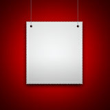 Blank hanging on red wall Stock Image