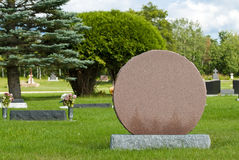 Blank Head Stone. A blank headstone in a cemetery or graveyard allowing the designer to put what they want on it Royalty Free Stock Photo