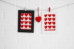 Blank heart paper frames on white brick wall royalty free stock images