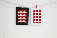 Blank heart paper frames on white brick wall royalty free stock photo
