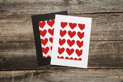 Blank heart paper frames on wooden background royalty free stock image