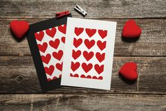 Blank heart paper frames on wooden background stock photography