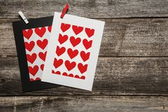 Blank heart paper frames on wooden background stock images