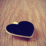 Blank heart-shaped chalkboard on a rustic wooden surface, with a Stock Photography