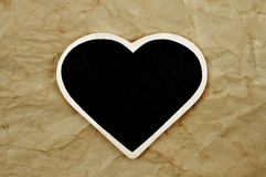 Blank heart-shaped frame on an old paper background Stock Photo