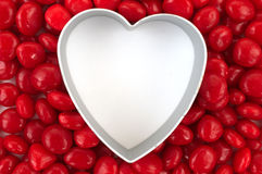 Blank heart surrounded with red candy Stock Photos