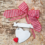 Blank heart on wooden background with red ribbon Stock Image