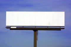 Blank Highway billboard. Blank billboard along highway with blue sky background royalty free stock photo
