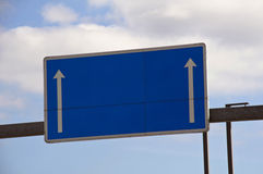 Blank Highway Sign. Blue blank highway sign in a summer day Stock Photography