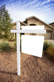Blank home for sale sign. A home for sale has a for sale sign that is blank for copy space.  Good image for designers to place text inferences such as for sale Stock Photos