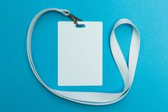 Blank ID card / badge with white belt isolated over background. Space for text stock photo