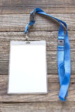 Blank ID card tag. On wooden background Stock Image