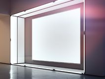 Blank indoor billboard in the dark room with light on the frame. 3d rendering. Blank bright indoor billboard in the dark room with light on the frame. 3d Stock Images