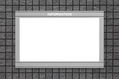 Blank information board on black brick wall Stock Photography