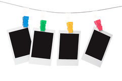 Blank instant photo. Prints on a washing line royalty free stock image