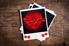 Blank instant photo. With a picture of the heart of roses on a wooden surface Royalty Free Stock Photos