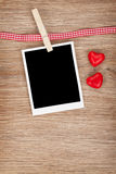 Blank instant photo with candy hearts Royalty Free Stock Photos